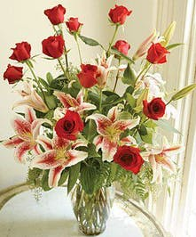 A Dozen Perfect Roses with Fragrant Lilies.